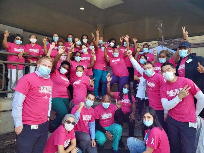 Group of employees wearing pink shirts